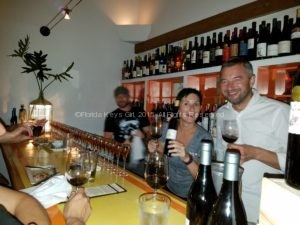 Yes, I'm behind the bar for a photo op with the winemaker.